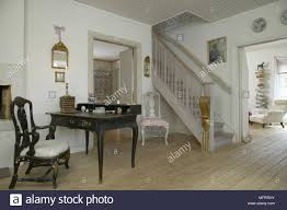next hallway furniture. Swedish Hallway With Bare Wooden Floorboards And Antique Furniture Next To Staircase Gold Banister. A