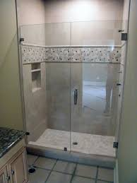 classy sharp mini bathroom supported by panel then glass shower doors design illuminated by light in