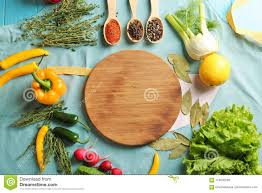 Wooden Board With Vegetables And Spices On Kitchen Table Stock