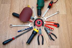 locksmith working. Assorted Working Tools For Locksmith Work On The Wooden Background \u2014 Photo By Feanaro