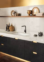 example of a thicker countertop design photo by corian designs featuring the zodiaq london sky quartz countertop