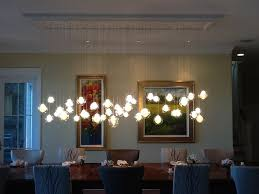kadur chandelier over dining room table custom blown glass chandelier modern contemporary dining on