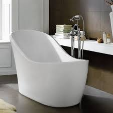 chaise lounge shaped stand alone bathtubs made of fiberglass combined with stainless steel faucet and white