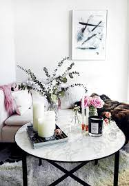 Decorating a round coffee table can seem a little more difficult than a square or rectangular coffee table. Ideas For How To Style A Round Coffee Table Apartment Therapy