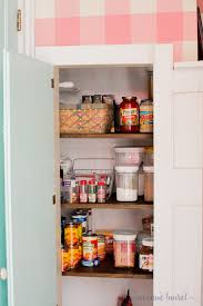 we totally transformed our small dysfunctional broom closet into an organized pantry we added