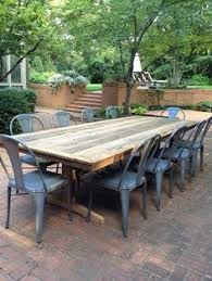 reclaimed barnwood farm table metal chairs perfect