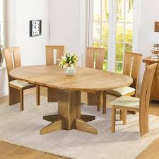 monty solid oak extending round dining table with 6 arley chairs