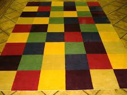 bright multi colored area rugs furniture row s thechowdown