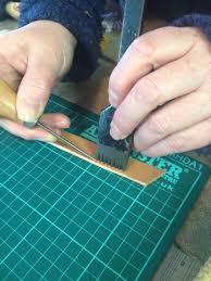 preparing to hand stitch the leather jpg