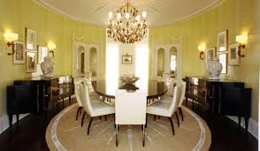 large round area rugs for dining room with yellow wall color ideas and chandelier light