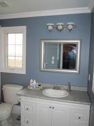beautiful chrome polished 3 light vanity fixture over rectangular wall mount mirror and single bowl sink