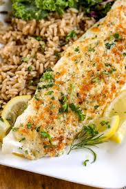 a close of of a parmesan crusted tilapia recipe on a plate with rice