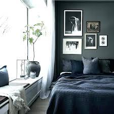 bedroom with gray walls dark grey walls post grey walls white cabinets dark floors dark