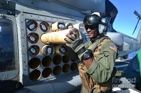 Naval Aircrewman Loads A Sonar Buoy