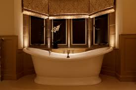 bathroom lighting tips. beautifully framed bath in a window recess bathroom lighting tips