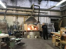 signoretti is a working glass factory where highly trained artisans create stunning works of art many that serve a practical purpose such as for lighting