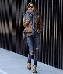 sasha simon is sleek and sophisticated in this leather jacket look pairing this brown piece