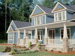 Blue Craftsman-Style Home With White Trim