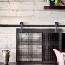 beautiful sliding fireplace screen the barn door trend is so fun but we