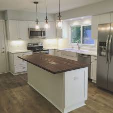 chopping block island. Plain Block Beautiful White Kitchen With Shaker Cabinets Subway Tile Backsplash  Carerra Marble Countertops And A Walnut Butcher Block Island Throughout Chopping Block Island C