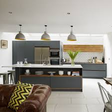 open plan kitchen with grey units and leather