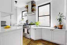 above a full line of cabinets dominate one wall in this galley while the windowed wall is kept fairly open the right windowsill was eliminated