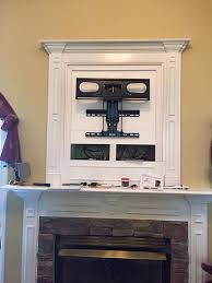 make that outdated hole above fireplace vanish by installing a flat screen tv covering it