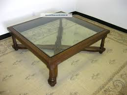 black wood glass top coffee table is crafted from solid knotty american oak and veneers this
