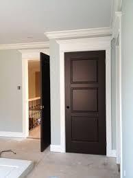 dark doors white trim by jose reyes