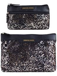 win one of 3 tender love carry cosmetic bag sets