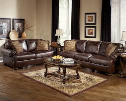 brown leather sectional sofa by bullard furniture with antique rug and black curtain for living room