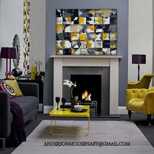 large modern wall art yellow and gray living room with accent wall