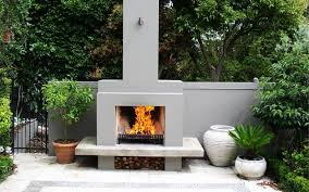 a built in wood burning outdoor fireplace its concept is to reveal only the fire concealing the place where it is housed designed by ivano