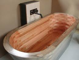 a beautiful grant on a wooden bathtub has been executed beautifully above by wooden baths ltd in scotland the object wears the name of a scottish
