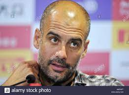 Head coach Pep Guardiola of Bayern Munich speaks at a press conference  after his team defeated Inter Milan during a friendly soccer match in  Shanghai Stock Photo - Alamy