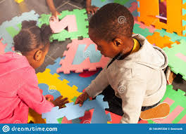 Two Kids Black Boy And Girl Play With Letters Stock Photo - Image of  background, child: 144497334