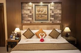 a bed or beds in a room at hotel krc palace