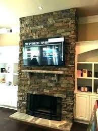 hanging tv over fireplace hanging over fireplace wall mount hang mounting a flat in fort above hanging tv over fireplace