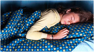 kids watching tv at night. a nap can help refresh tired child. kids watching tv at night r