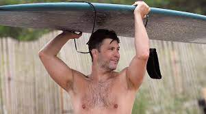 Colin Jost Goes Shirtless While Surfing ...
