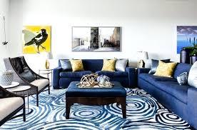 blue sofa living room blue sofa blue pattern area rug brown armchairs with cream cushions gold blue sofa