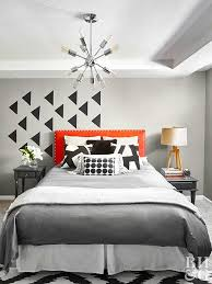 Decorate a bedroom with punchy fabrics and expressive patterns. Choose  interesting lighting, such as a charming chandelier or sculptural table  lamps.
