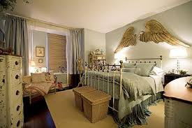 carved angel s wings mounted over the bed