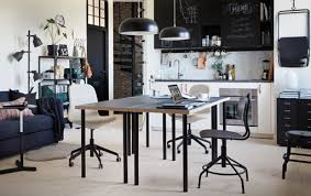 home office furniture ikea. a black and white kitchen with two tables backtoback in the centre home office furniture ikea e