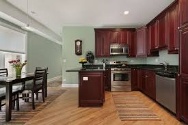 red kitchen wall colors. Kitchen. Green Wall Theme And Dark Red Wooden Kitchen Cabinet Added By Brown Striped Rug Colors E