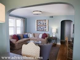 Blue living room with Brown Sectional | brown sofa design and blue wall in  modern living