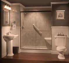 interesting bathtub shower combo with beige tile and glass enclosure also wainscoting and pedestal sink