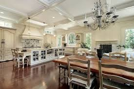 Large Open Living White Kitchen With Elaborate Rectangle Kitchen Island.