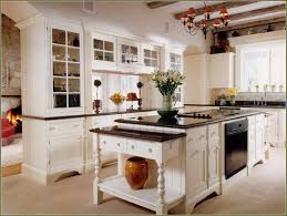 white kitchen cabinets with black granite photo of antique white kitchen cabinets with black granite