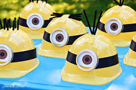 Minion Birthday Party Ideas: Party hat decorations by Tidbits and Twine